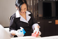 Joyful nice hotel maid doing the room cleaning Stock Images