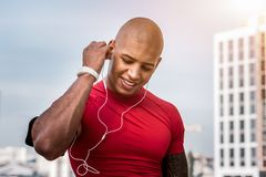 Joyful nice man wanting to hear the music. Favourite tunes. Joyful nice man wearing headphones while wanting to listen to music royalty free stock photo