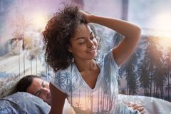 Joyful nice woman having a good rest. I feel great. Joyful nice good looking women closing her eyes and touching her hair while feeling great after a good rest royalty free stock photo