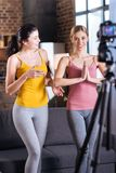 Joyful nice women exercising in front of the camera Royalty Free Stock Images