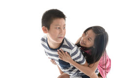 Joyful older brother giving younger sister Stock Images