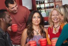 Joyful olika vuxen människa med kaffe Royaltyfri Bild
