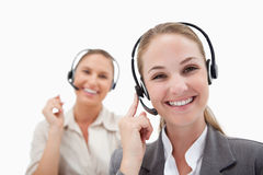 Joyful operators using headsets Royalty Free Stock Photos