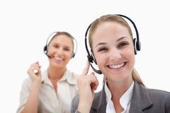 Joyful operators using headsets Royalty Free Stock Photos