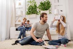 Joyful parents playing with their children at home stock images