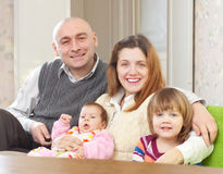 Joyful parents with their two kids Royalty Free Stock Image