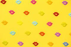 Joyful yellow pattern of colorful lips royalty free stock images