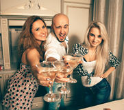 Joyful people at a party with a martini Royalty Free Stock Image
