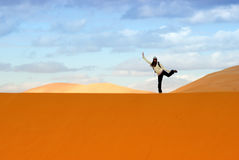 Joyful position on the dune Stock Image