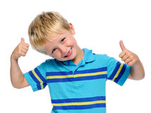 Joyful positive boy. Little boy gives a thumbs up sign and is happy royalty free stock photography