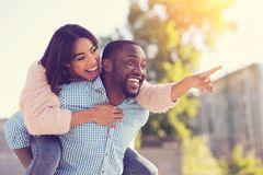 Joyful positive couple having fun together. Pleasurable moments. Joyful positive nice couple laughing and having fun together while being on a date Stock Photography
