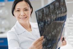 Joyful positive doctor being happy for her patient Stock Photography