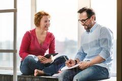 Joyful positive middle aged couple enjoying the weekend at home Stock Photo