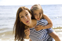 Joyful and positive mother and daughter near the sea Royalty Free Stock Image
