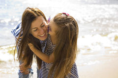 Joyful and positive mother and daughter near the sea Royalty Free Stock Photography