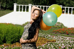 Joyful pregnant girl with colorful balloons Stock Photography