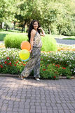 Joyful pregnant girl walking in park Royalty Free Stock Images
