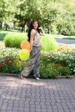 Joyful pregnant girl walking in park Royalty Free Stock Images
