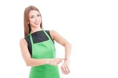 Joyful pretty employee pointing her wrist Royalty Free Stock Images