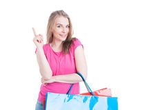 Joyful pretty female carrying shopping bags and having an idea Stock Photo