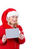 Joyful pretty santa woman with empty sign Royalty Free Stock Photography
