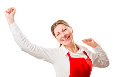 Joyful pretty woman in a red apron Royalty Free Stock Photography