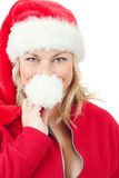 Joyful pretty woman in red santa claus hat smiling Stock Photo