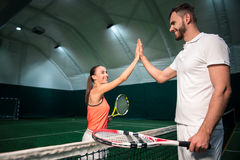Joyful professional players going to play tennis Royalty Free Stock Photography
