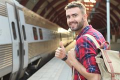 Joyful public transportation passenger giving a thumbs up.  stock image