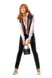 Joyful red-haired young woman with handbag Royalty Free Stock Photos