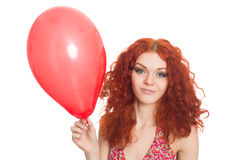 Joyful redhead girl holding balloon Royalty Free Stock Image