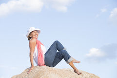 Joyful relaxed smiling woman on top of mountain Royalty Free Stock Image