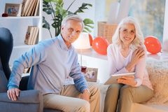 Joyful retired husband and wife relaxing at home together Royalty Free Stock Photos