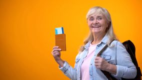Free Joyful Retiree Woman Showing Passport And Tickets, Preparing For Travel Tour Stock Photography - 145149522