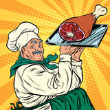Joyful retro cook with meat foot Royalty Free Stock Photo