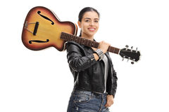 Joyful rock girl with a guitar. Isolated on white background Stock Photos