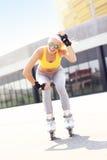 Joyful roller blader in the city Stock Images
