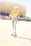 Joyful roller blader in front of Amber Stadium Royalty Free Stock Photo