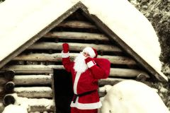 Joyful Santa Claus in his house. royalty free stock image