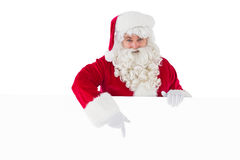 Joyful santa claus presenting sign Royalty Free Stock Photo