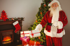 Joyful santa delivering gifts at christmas eve Royalty Free Stock Photos