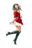 Joyful Santa girl jumping in mid air. Full body length portrait isolated over white studio background Royalty Free Stock Photos