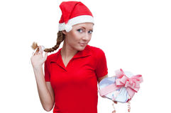 Joyful Santa helper with heart-shaped present box Stock Photos