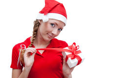 Joyful Santa helper openning present box Royalty Free Stock Images