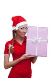 Joyful Santa helper with pink present box Royalty Free Stock Image
