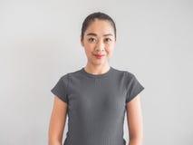 Joyful and satisfied Asian woman. Joyful and satisfied Asian woman portrait royalty free stock photography