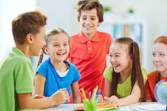 Joyful schoolkids Stock Images