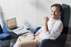 Joyful senior businessman expressing positive emotions Stock Photography
