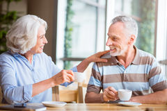 Joyful senior couple sitting at the table Royalty Free Stock Photography