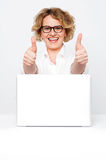 Joyful senior executive showing double thumbs up Royalty Free Stock Images